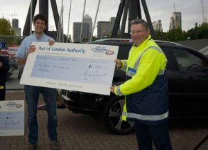 PLA Chairman Simon Sherrard presents a cheque to the Watersports Centre