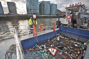 Litter and debris being collected from the Thames