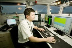 A Pla Surveyor at work on the Survey Vessel 'Yantlet'