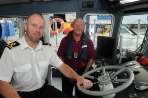 Cllr Derek Sales with the PLA's John Studd onboard the PLA launch
