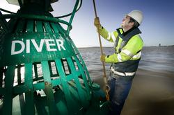 Maintenance work on a navigation buoy