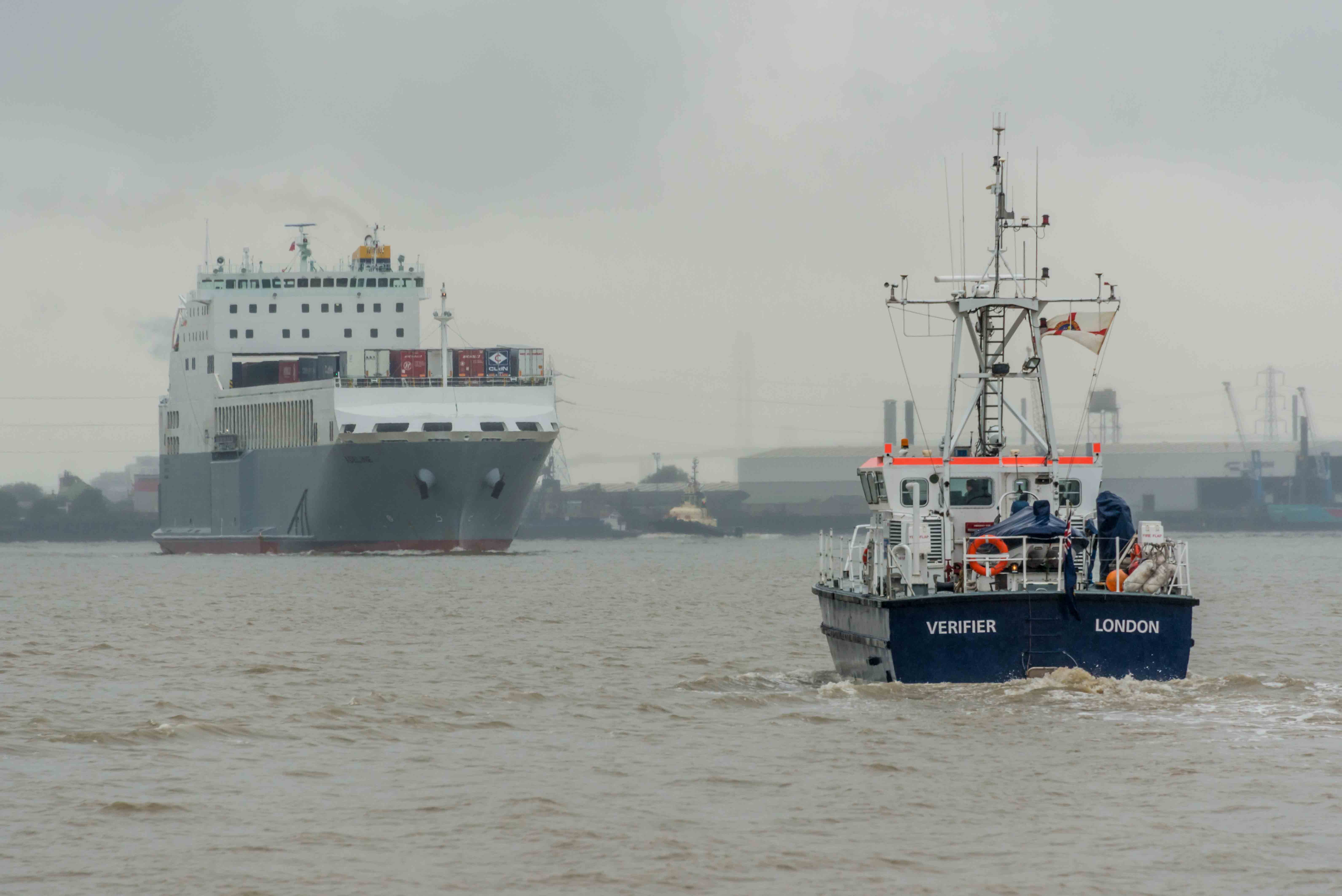 Photograph of two ships, one is PLA survey vessel VERIFIER