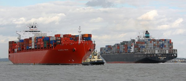 Container ships pass in Gravesend Reach