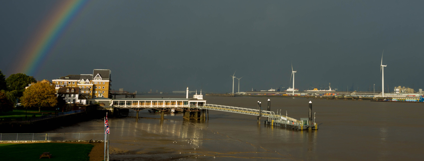Image of Gravesend Town Pier under a rainbow.