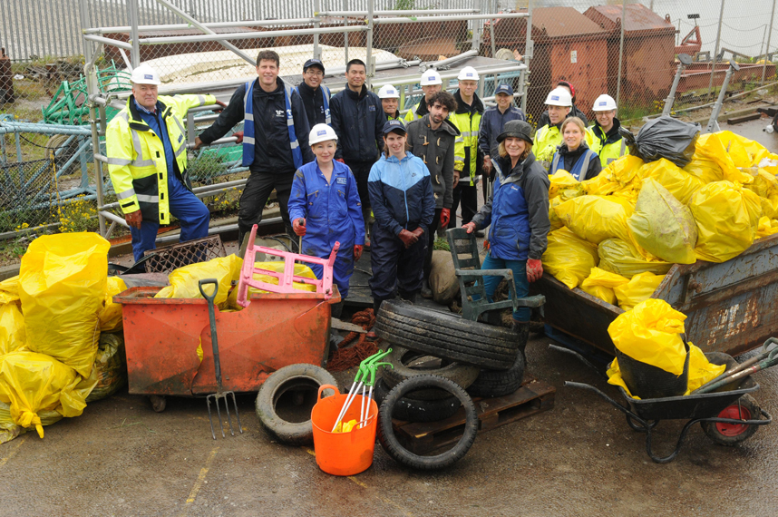 PLA and Thames21 clean up team with the tyres, chair, wheelie bin and bags of rubbish cleared from the foreshore
