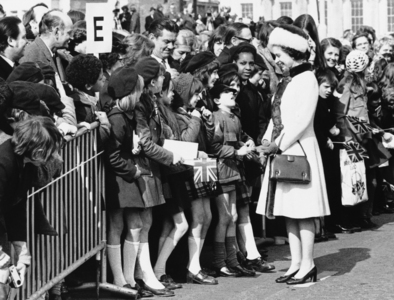 Queen Elizabeth II stops to greet young children on the New London Bridge over the River Thames in London on March 16, 1973