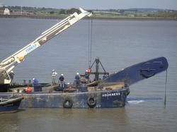 Salvage Vessel 'Hookness' lifting an underwater obstruction