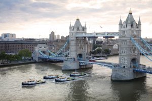 Cory Environmental's four new tugs pass under Tower Bridge