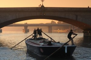 Blackwall passes under Putney Bridge at dawn