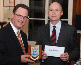 PLA chief harbour master (left) David Phillips presenting rowing safety award